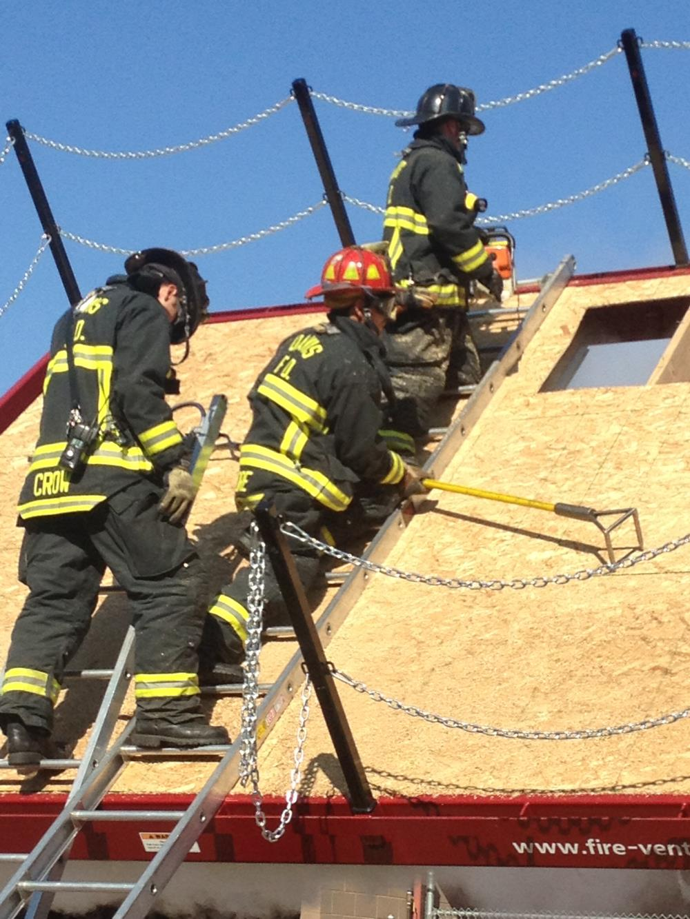 Firefighters at training on roof