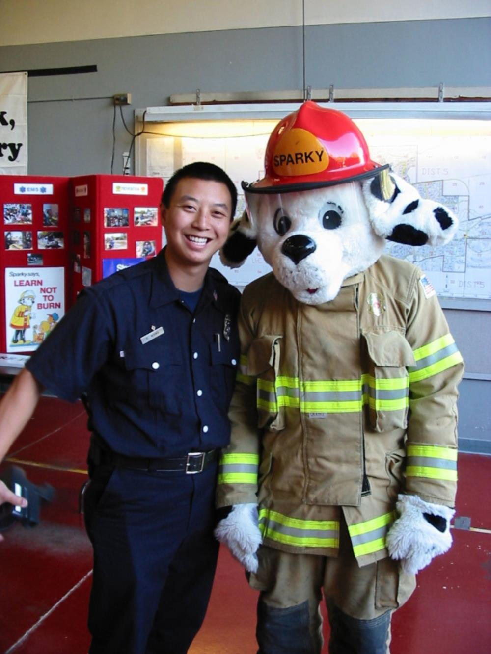 Firefighter with Sparky Mascot