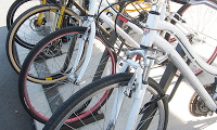 Bicycle parking rack with front bicycle wheels visible