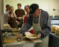 seniorserving a meal in the kitchencenter-history2